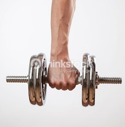Hand holding chrome dumbbell on the white background.
