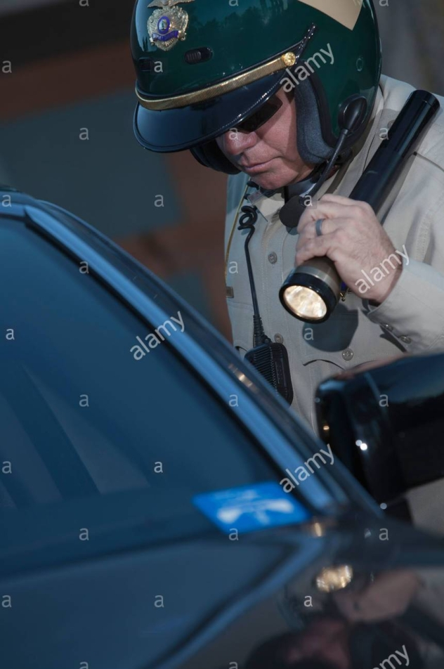 nightwatch-patrolman-with-flashlight-c23a76.jpg