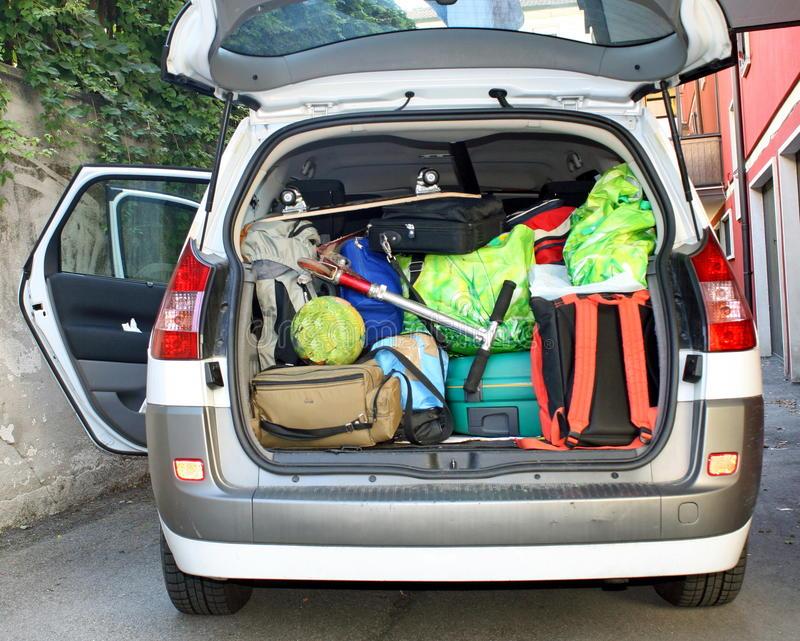 very-car-trunk-full-luggage-23584388.jpg